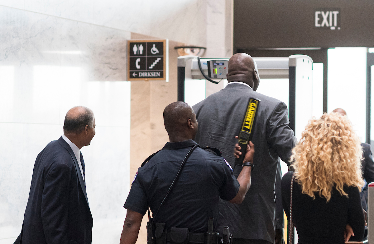 "UNITED STATES - NOVEMBER 30: Shaquille O'Neal is wanded by U.S. Capitol Police after he set off the metal detectors while arriving in the Hart Senate Office Building on Wednesday, Nov. 30, 2016. Shaq was on Capitol Hill to host the ""Recognizing Law Enforcement's Critical Role in the Fight Against Impaired Driving"" briefing with Responsibility.org. (Photo By Bill Clark/CQ Roll Call)"