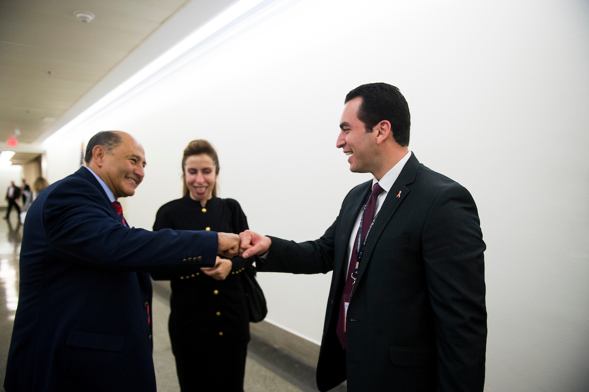 Rep.-elect Lou Correa, D-Calif., left, gives Rep.-elect Ruben Kihuen, D-Nev., a fist bump in the basement of the Longworth House Office Building after the New Member Orientation Room Lottery Draw for office space at the Capitol on Thursday. Correa won first pick of office space while Kiuhen gets the 30th pick. (Photo By Bill Clark/CQ Roll Call)