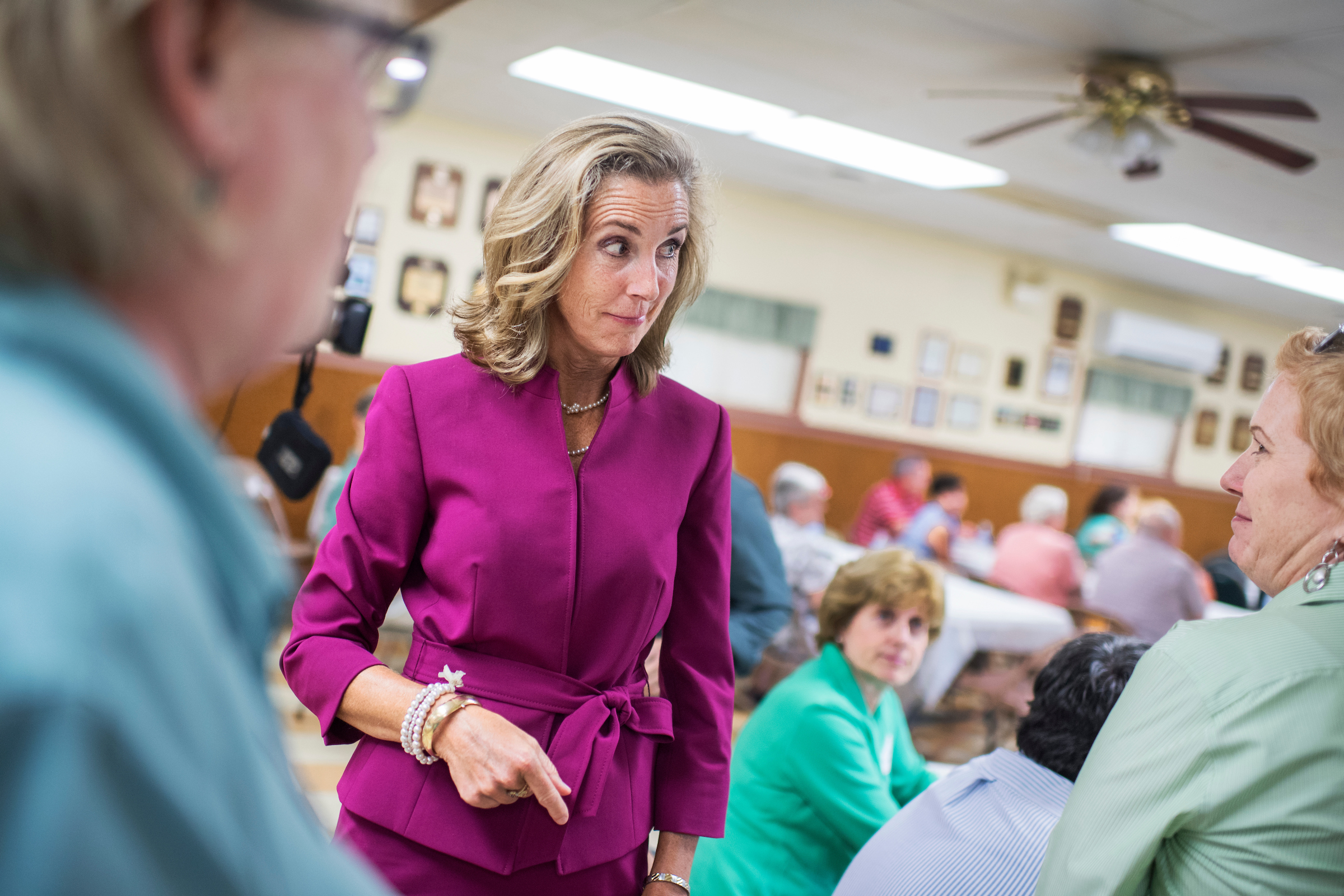UNITED STATES - AUGUST 17: Katie McGinty, Democratic candidate for Pennsylvania Senate, talks with guests during the Annual Penn Ag Democrat Barbeque at the Ferguson Township Lions Club in Pine Grove Mills, Pa. August 17, 2016. (Photo By Tom Williams/CQ Roll Call)