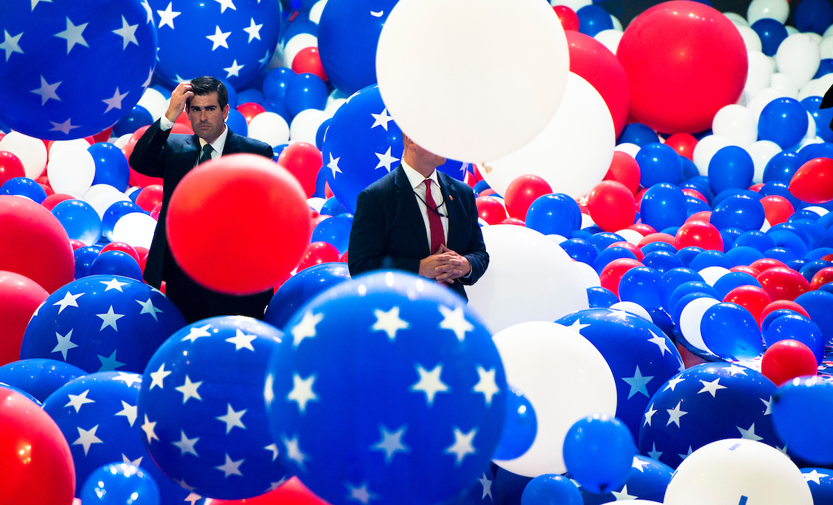 "18. July 28: Secret Service agents guard the stage as balloons drop at the end of the Democratic National Convention in Philadelphia. <a class=""memberLink"" title=""Click to view member info in a new window"" href=""http://data.rollcall.com/members/7201?rel=memberLink"" target=""_blank"">Hillary Clinton</a> became the first woman to win the nomination of a major political party for president of the United States. (Bill Clark/CQ Roll Call file photo)"