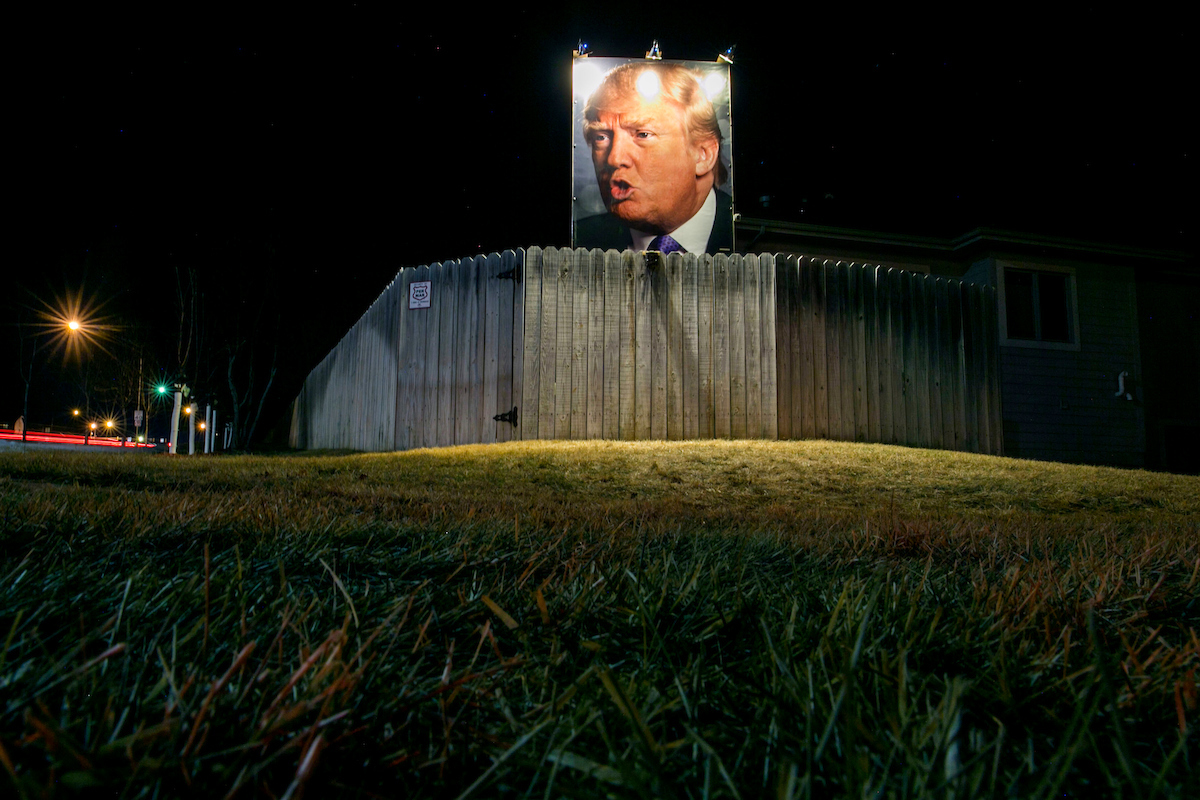 5. Jan. 27: In this long exposure photo, a giant poster of Republican presidential candidate Donald Trump stands on display in supporter George Davey's backyard in West Des Moines, Iowa. (Al Drago/CQ Roll Call file photo)