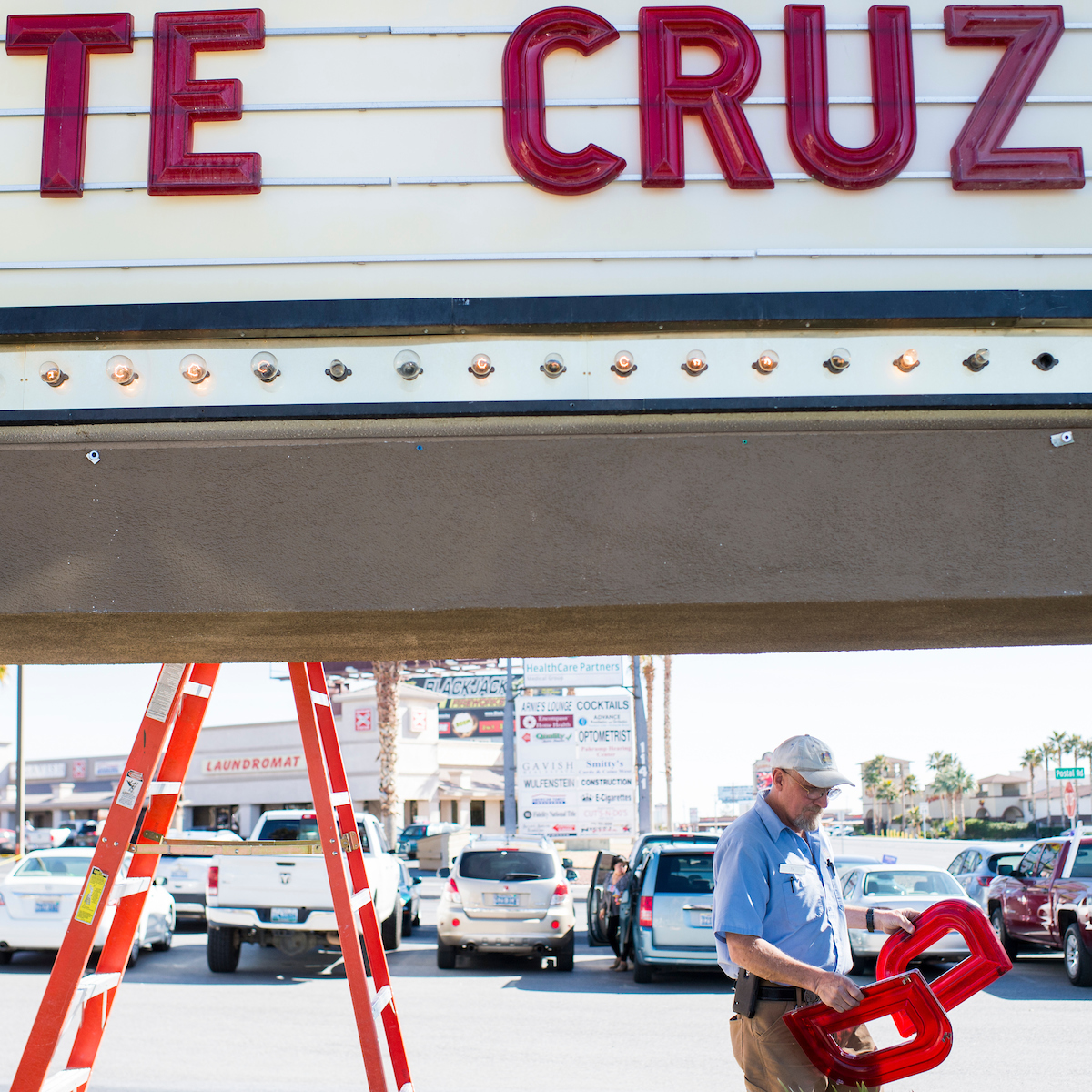 "6. Feb. 21: T.J. Vanderford, from the Pahrump Best Western maintenance crew, carries ""D""s to the hotel's sign at the site of a campaign rally for Texas Sen. <a class=""memberLink"" title=""Click to view member info in a new window"" href=""http://data.rollcall.com/members/44748?rel=memberLink"" target=""_blank"">Ted Cruz</a> in Pahrump, Nev. The sign read ""TE CRUZ"" until they could find a ""D"" back in the office. The Nevada GOP caucus took place two days later. (Bill Clark/CQ Roll Call file photo)"