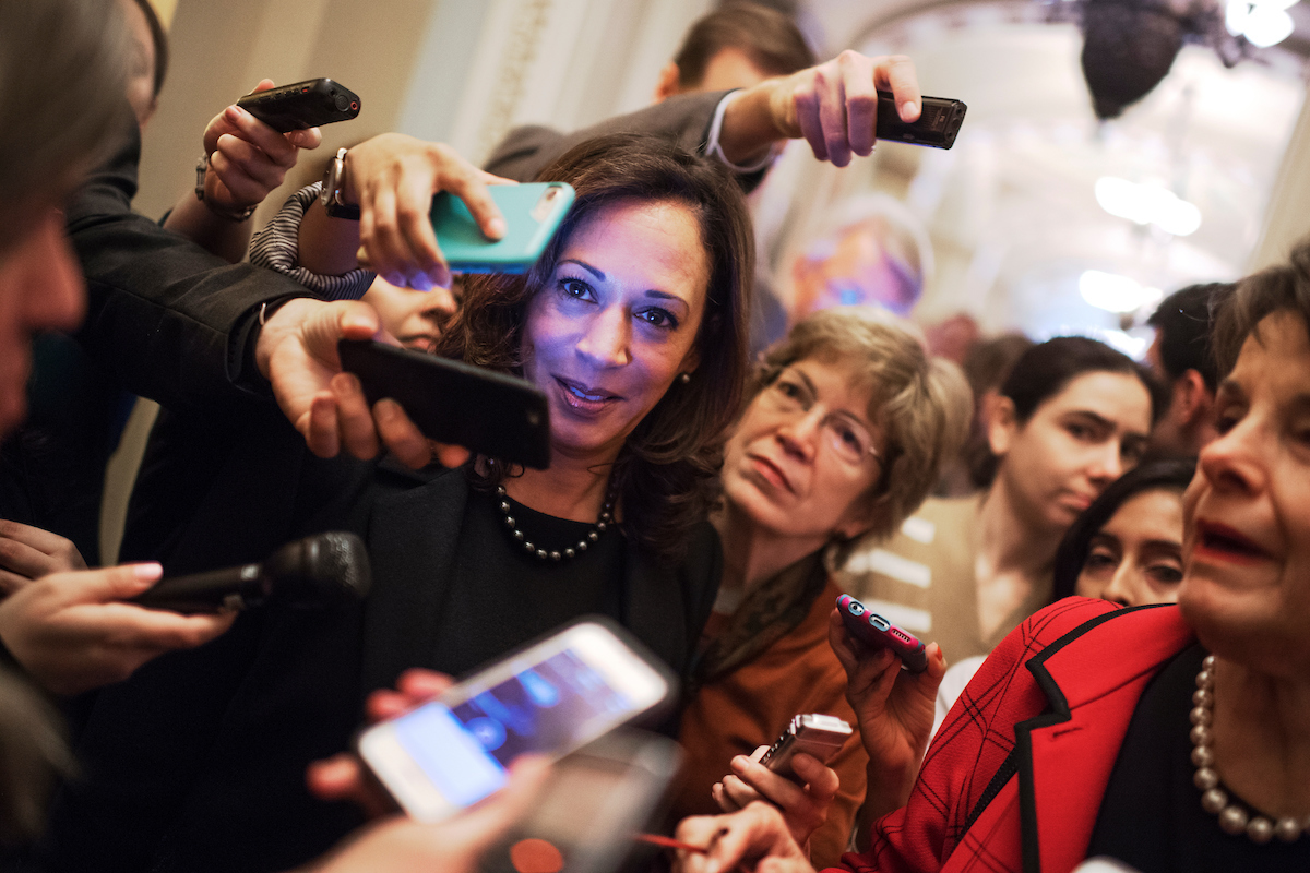 "29. Nov. 16: California Sen.-elect <a class=""memberLink"" title=""Click to view member info in a new window"" href=""http://data.rollcall.com/members/97833?rel=memberLink"" target=""_blank"">Kamala Harris</a> is surrounded by reporters who were questioning California Sen. <a class=""memberLink"" title=""Click to view member info in a new window"" href=""http://data.rollcall.com/members/80?rel=memberLink"" target=""_blank"">Dianne Feinstein</a>, after the Senate Democratic Caucus leadership elections in the Capitol. (Tom Williams/CQ Roll Call file photo)"