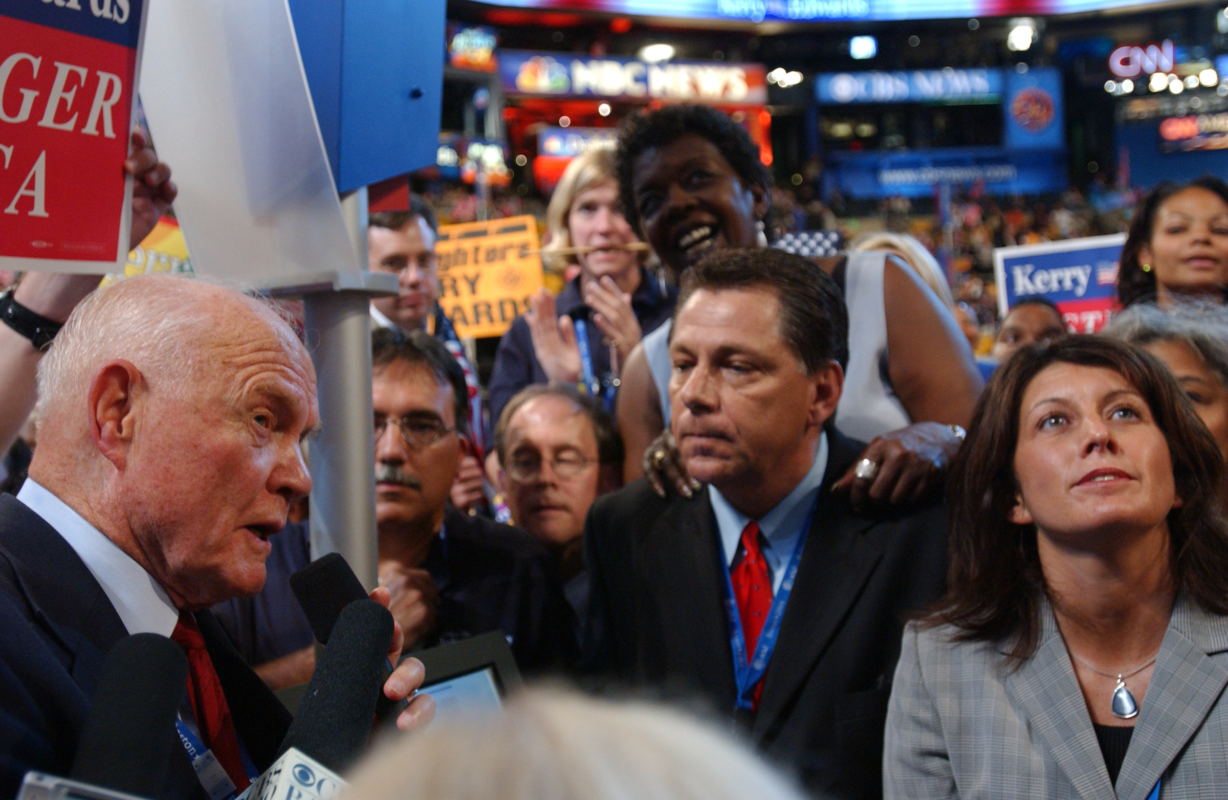 July 25, 2004: Sen. John Glenn, far left, U.S. Rep. Stephanie Tubbs Jones, D-Ohio, background middle, Ohio Democratic Party Chair Dennis L. White, in red tie, and wife Mary White, announce their state's votes during the roll call at the Democratic National Convention. (Photo by Scott J. Ferrell/CQ Roll Call)