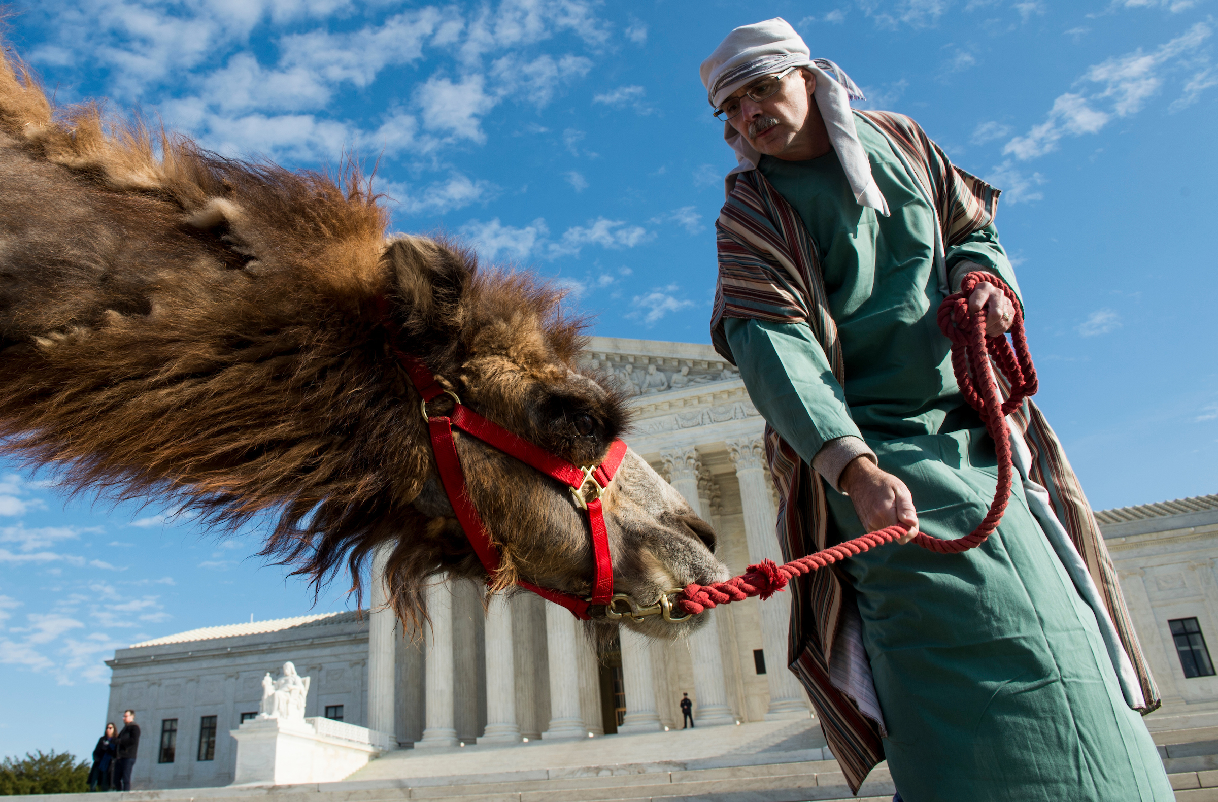 "Faith & Action in the Nation's Capital holds its annual ""Live Nativity on Capitol Hill,"" with actors portraying Mary, Joseph and the baby Jesus, a donkey and two camels in front of the U.S. Supreme Court on Wednesday, Dec. 7, 2016. (Photo By Bill Clark/CQ Roll Call)"