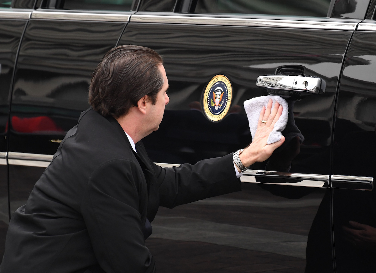 A Secret Service member wipes down one of the presidential limousines. (Bill Clark/CQ Roll Call)
