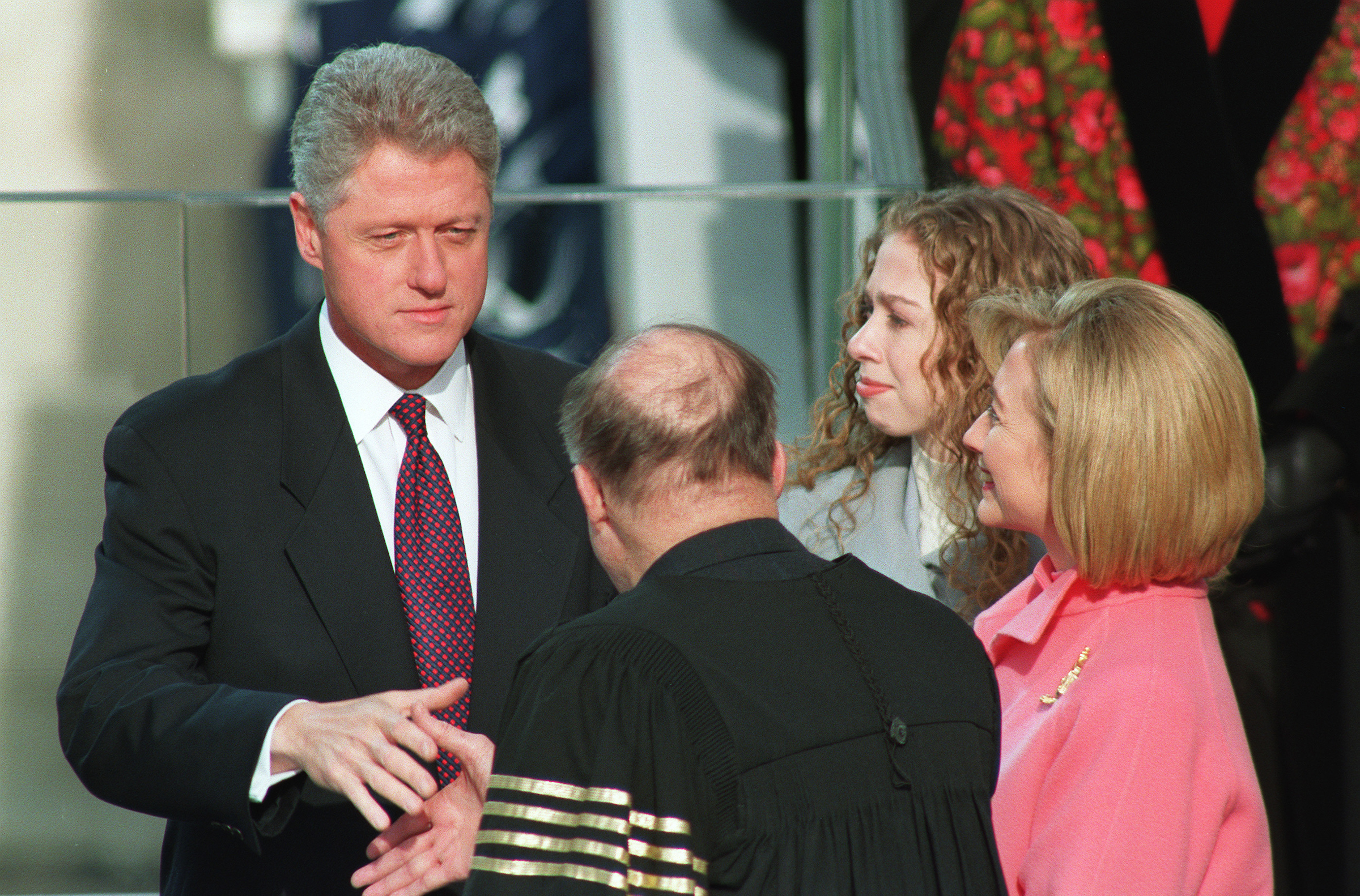 Clinton shakes Supreme Court Chief Justice William Rehnquist's hand after his swearing-in in 1997. (Scott J. Ferrell/CQ Roll Call file photo)