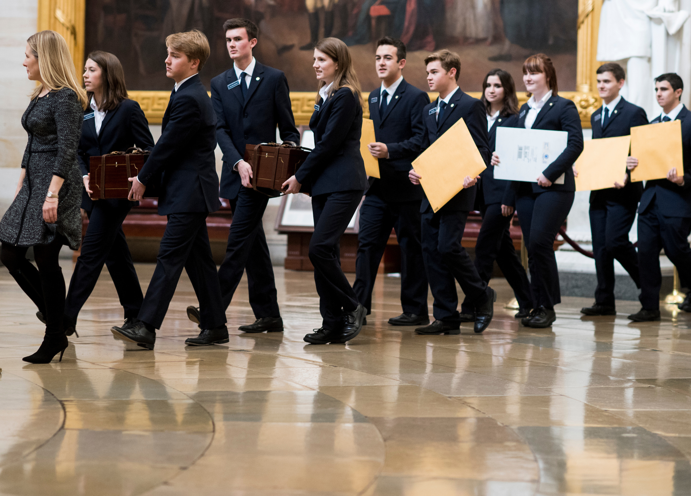Senate pages lead the procession of the Senate through the U.S. Capitol Rotunda into the House chamber with the Electoral College ballot boxes on Friday. (Bill Clark/CQ Roll Call)