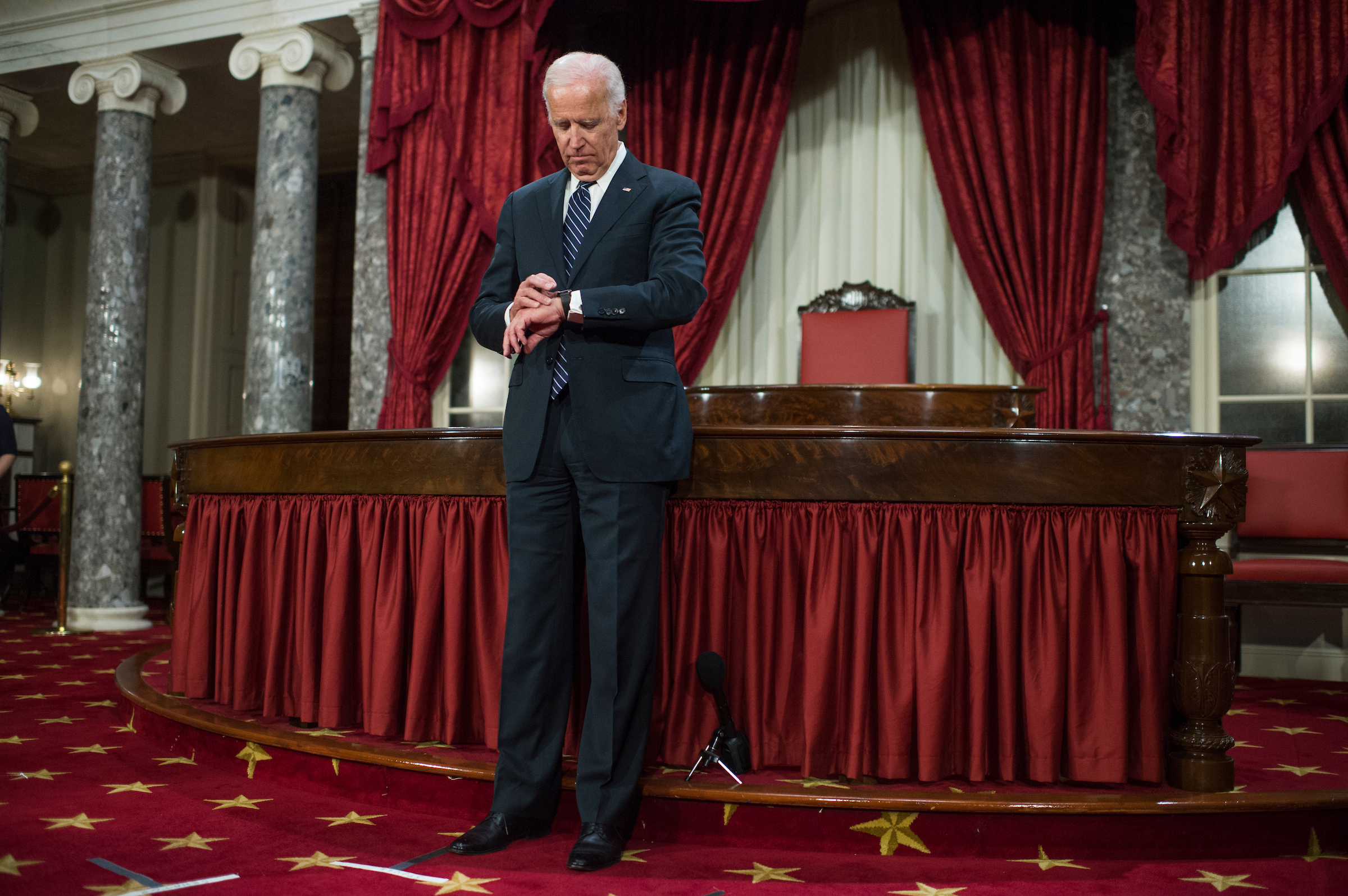 Biden waits for the next senator during the ceremonial swearings-in in the Old Senate Chamber on Tuesday. (Tom Williams/CQ Roll Call)