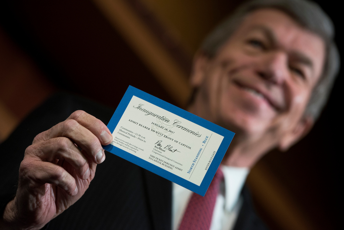 "Missouri Sen. <a class=""memberLink"" title=""Click to view member info in a new window"" href=""http://data.rollcall.com/members/274?rel=memberLink"" target=""_blank"">Roy Blunt</a> reveals the ticket for Inauguration Day at a news conference on Thursday. (Tom Williams/CQ Roll Call)"