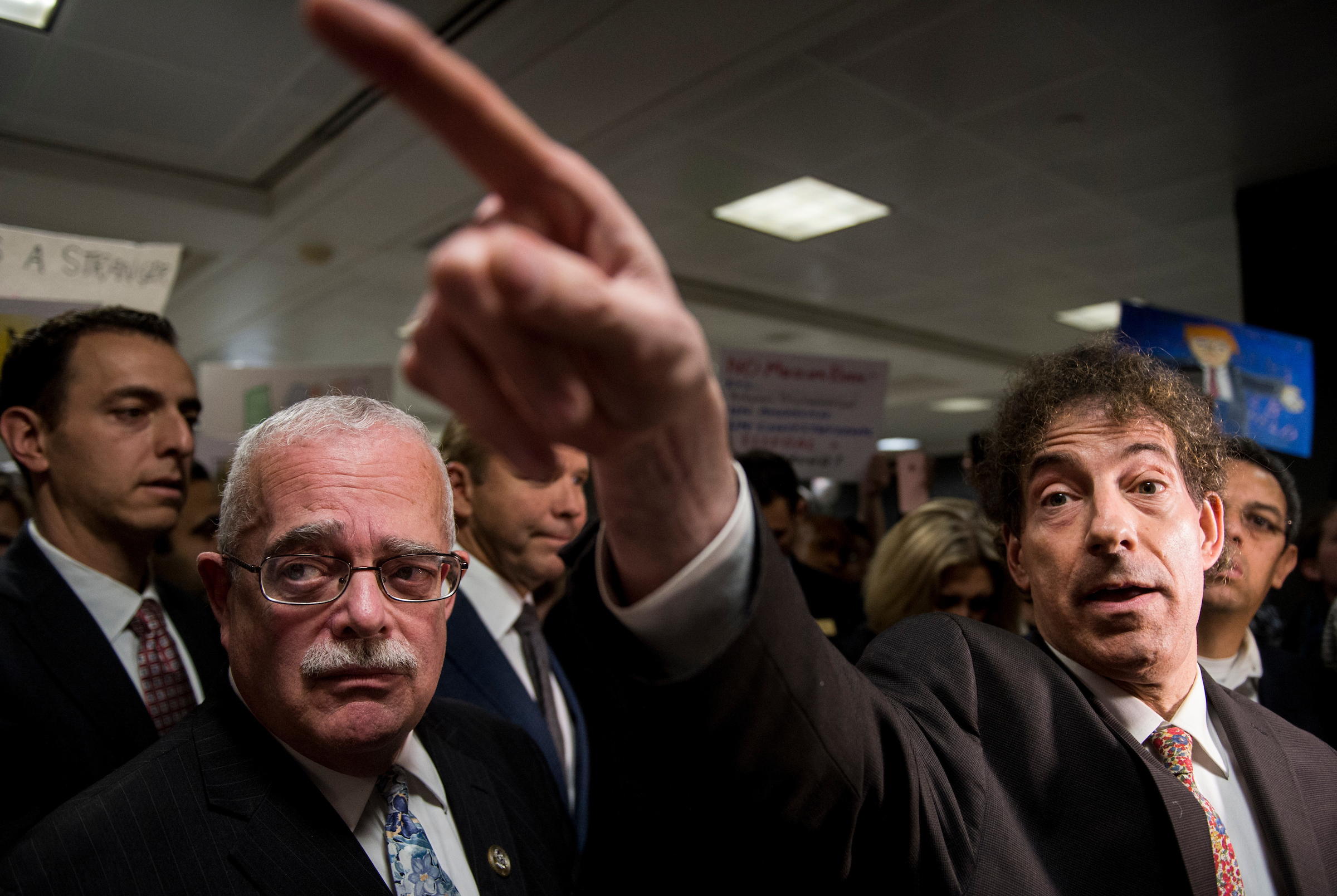 UNITED STATES - JANUARY 29: From left, Rep. Gerry Connolly, D-Va., and Rep. Jamie Raskin, D-Md., speak to the press and protesters about possible detention of travelers and legal access at Dulles International Airport in Virginia on Sunday, Jan. 29, 2017. Also participating were Rep. Don Beyer, D-Va., and Rep. John Delaney, D-Md. Protests erupted at airports around the country following President Trump's executive order restricting travel from several Islamic countries. (Photo By Bill Clark/CQ Roll Call)