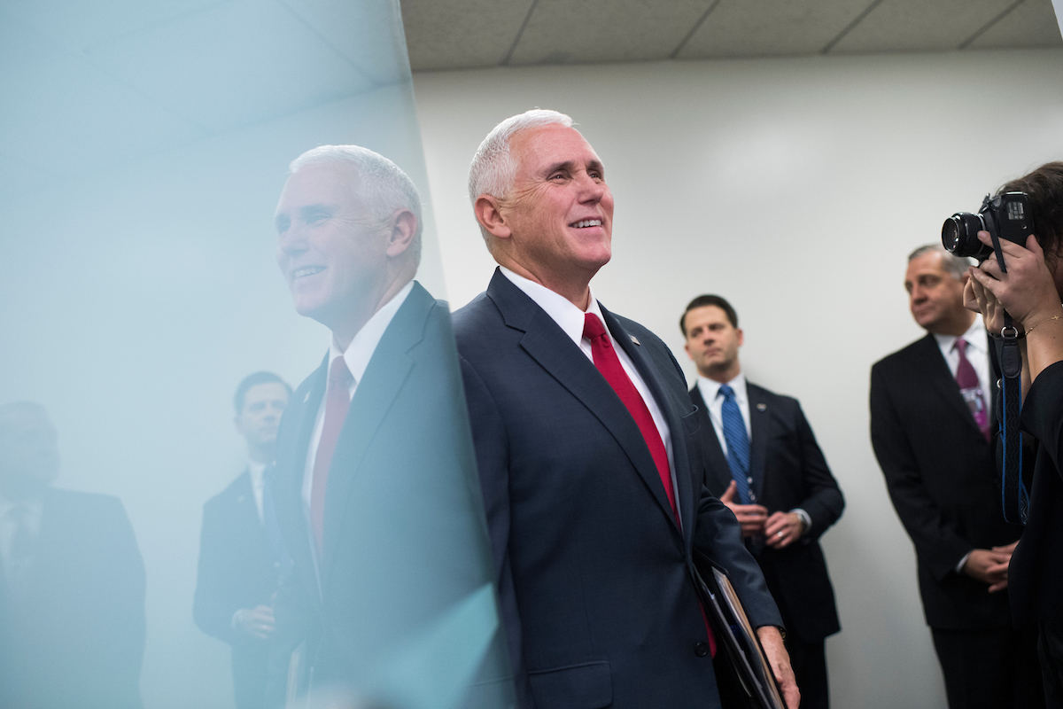 Vice President-elect Mike Pence arrives for a news conference on Capitol Hill on Wednesday. (Tom Williams/CQ Roll Call)