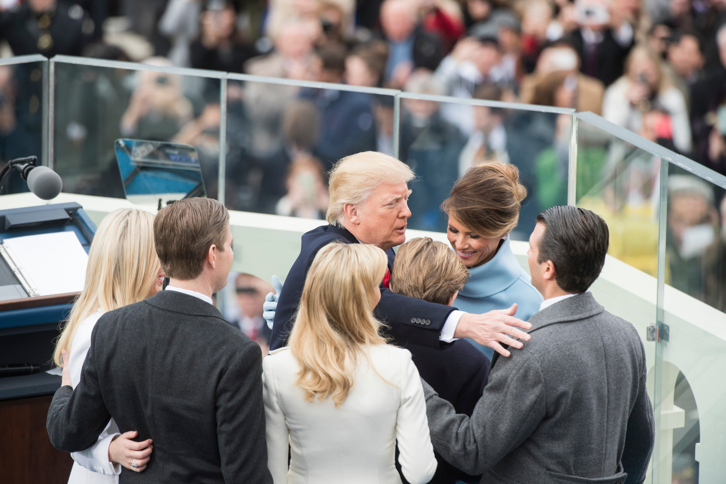 Trump hugs his family after being sworn in. (Tom Williams/CQ Roll Call)