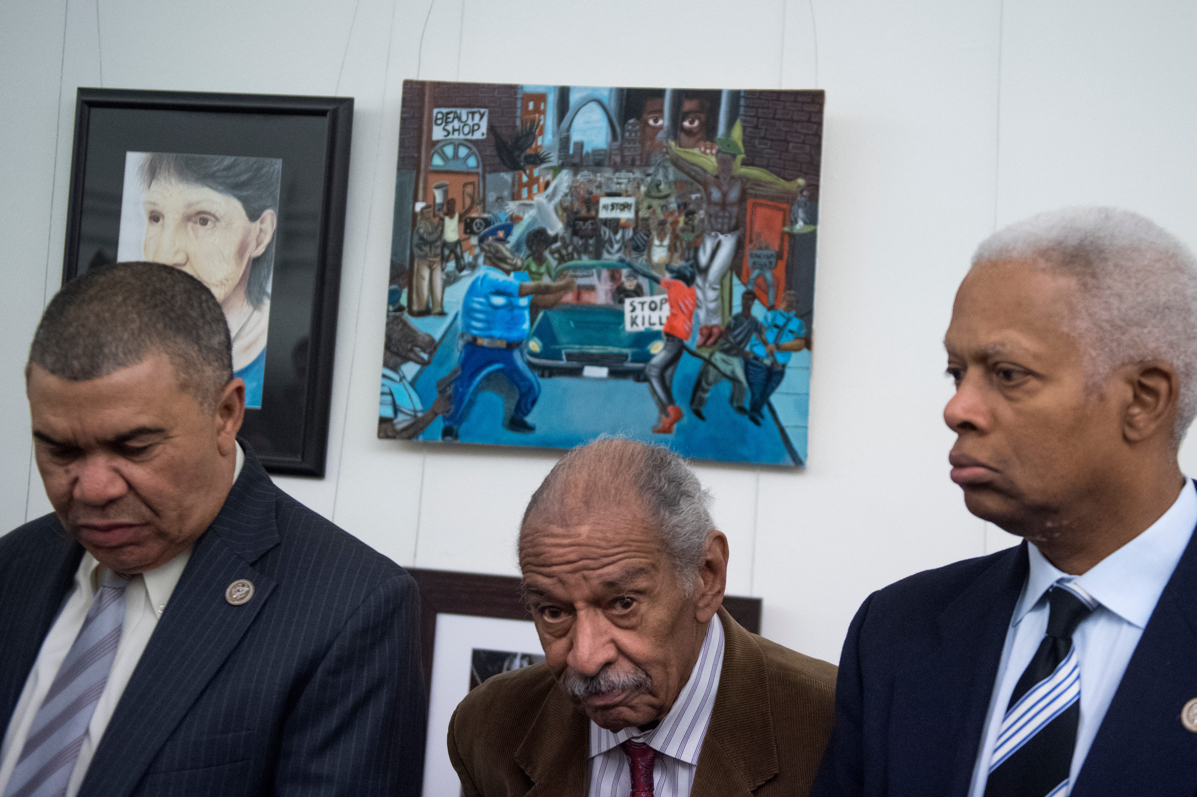 From left, Clay, Conyers and Johnson in front of the painting in the Cannon tunnel on Tuesday. (Tom Williams/CQ Roll Call)