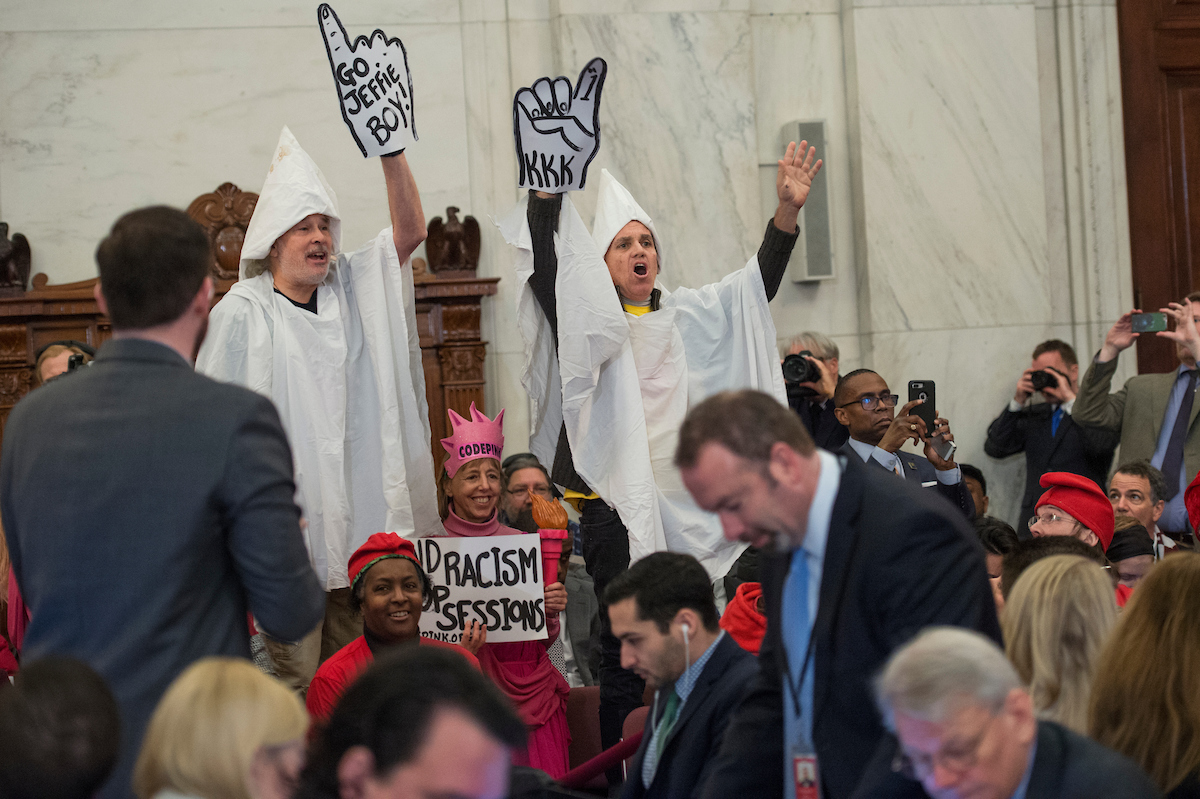 Protesters disrupt the Senate Judiciary Committee hearing on Sessions. (Tom Williams/CQ Roll Call)