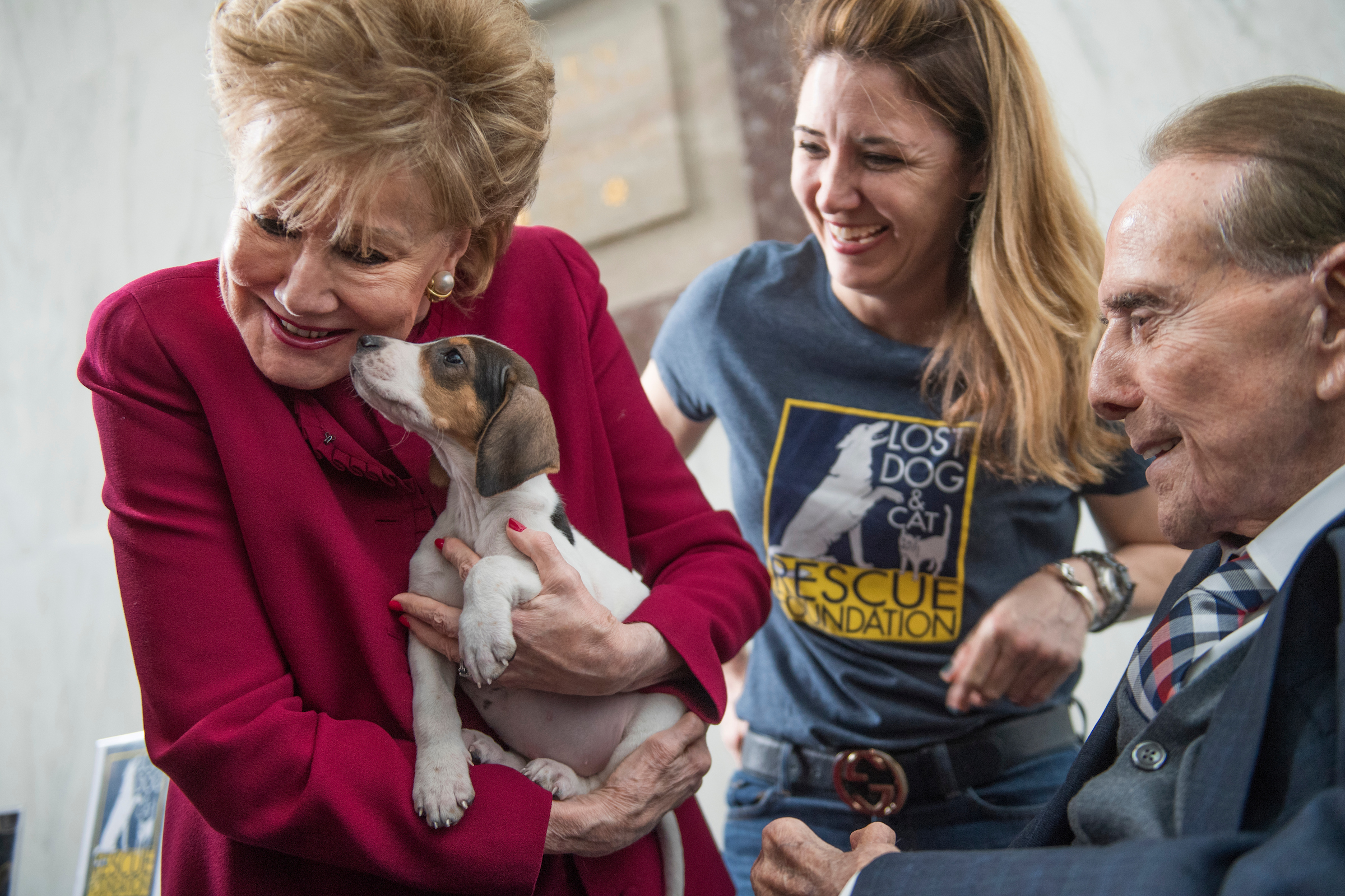 """UNITED STATES - FEBRUARY 14: Former Sen. Bob Dole, R-Kan., and his wife former Sen. Elizabeth Dole, R-N.C., attend the """"Paws for Love,"""" Valentine's Day animal adoption event in Rayburn Building to draw attention to the plight of rescue animals, February 14, 2017. The event was hosted by the ASPCA and the Congressional Animal Protection Caucus. (Photo By Tom Williams/CQ Roll Call)"""