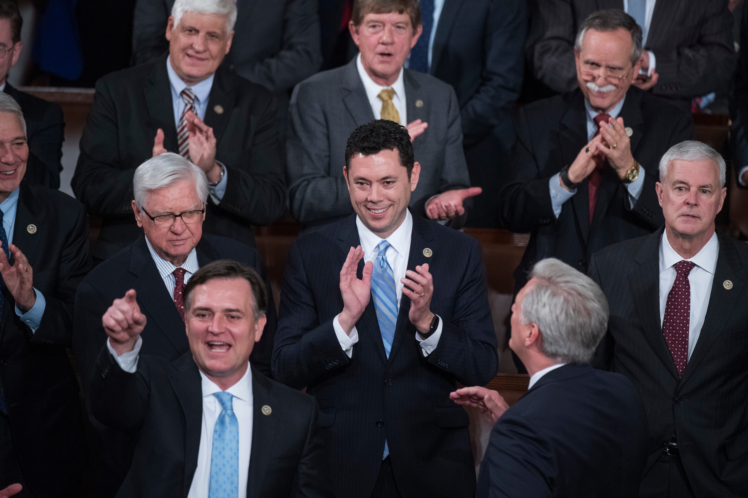 UNITED STATES - FEBRUARY 28: Reps. Jason Chaffetz, R-Utah, center, and Luke Messer, R-Ind., lower left, are seen with other GOP members in the House Chamber before President Donald Trump addressed a joint session of Congress in the Capitol, February 28, 2017. (Photo By Tom Williams/CQ Roll Call)