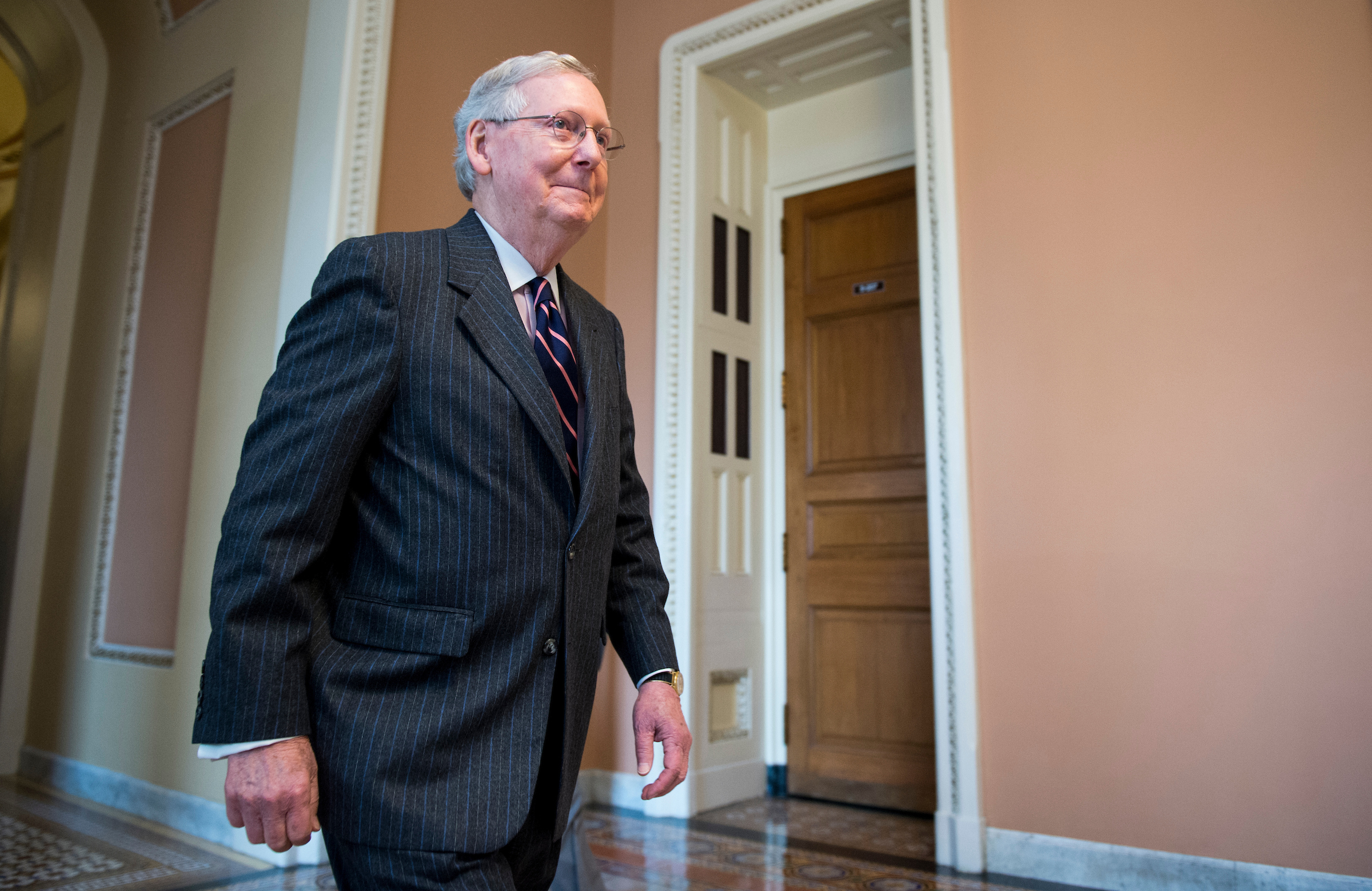 UNITED STATES - FEBRUARY 7: Senate Majority Leader Mitch McConnell, R-Ky., walks back to his office following the vote to confirm Betsy Devos to be Secretary of Education on Tuesday, Feb. 7, 2017. (Photo By Bill Clark/CQ Roll Call)