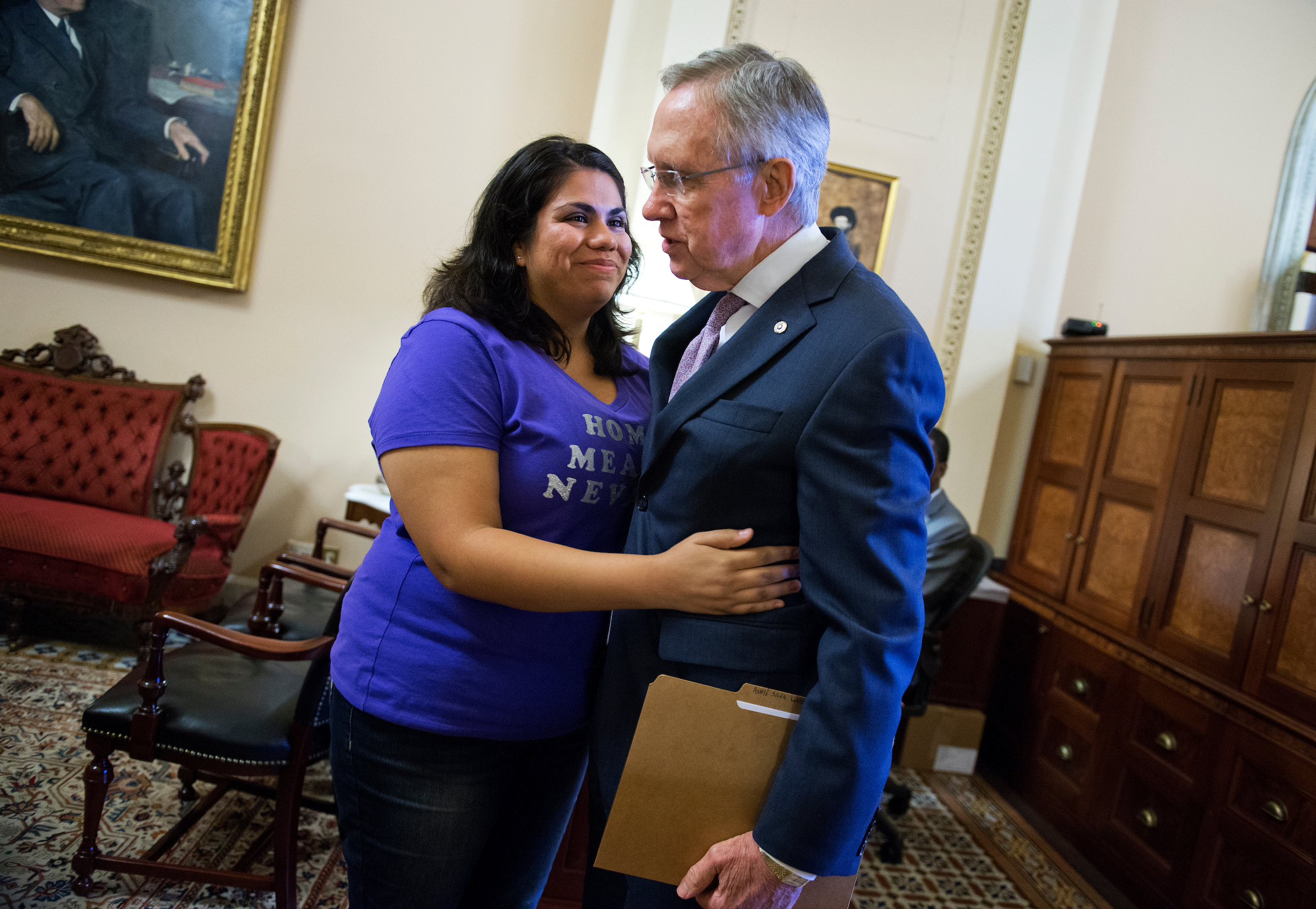 Astrid Silva of Nevada, pictured with former Senate Majority Leader Harry Reid, will deliver the Spanish language response to Trump's address. (Photo By Tom Williams/CQ Roll Call file photo)