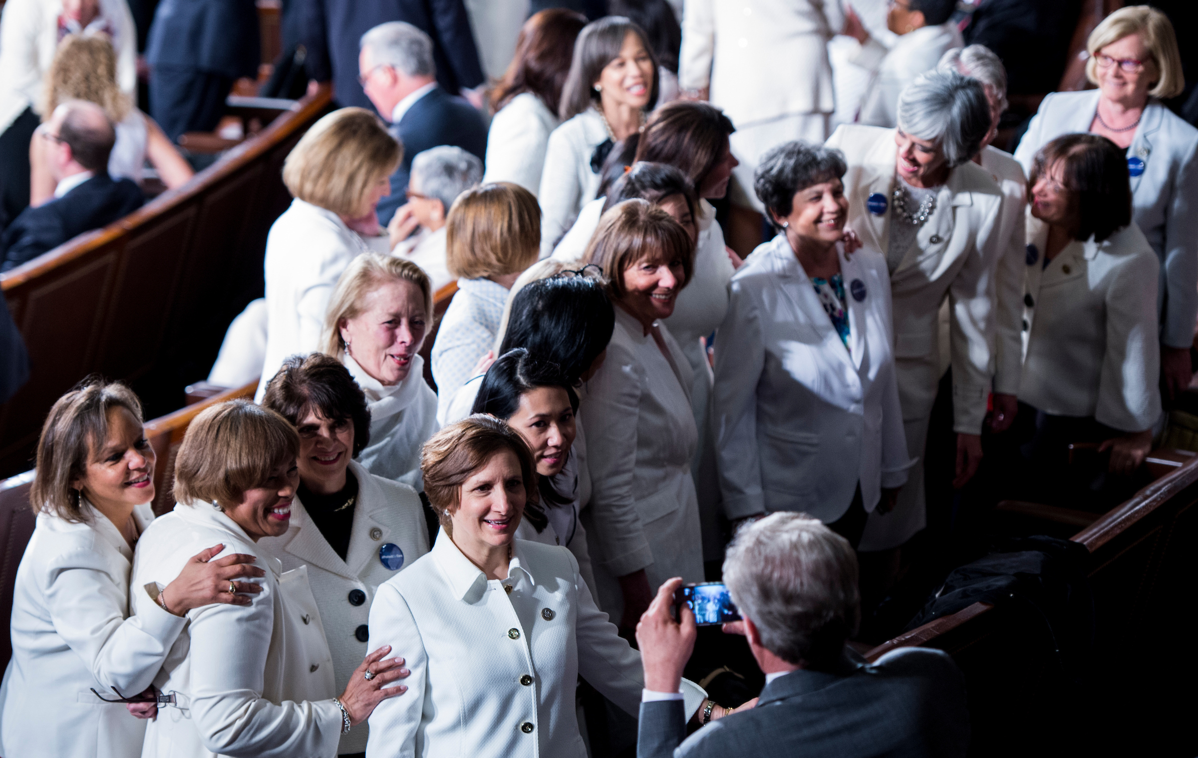 UNITED STATES - FEBRUARY 28: Rep. Frank Pallone, D-N.J., takes a group photo of women Democrats wearing all white for President Donald Trump's address to a joint session of Congress on Tuesday, Feb. 28, 2017. (Photo By Bill Clark/CQ Roll Call)