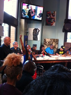 Ayanna Gregory sings at the beginning of the panel discussion at Busboys and Poets. (Bridget Bowman/CQ Roll Call)