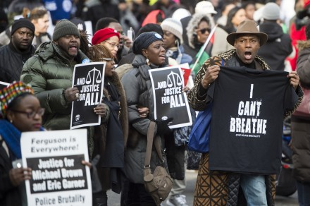 "Thousands of protesters participate in the ""Justice For All"" march against police violence on Pennsylvania Avenue in Washington on Saturday, Dec. 13, 2014. Protesters held a rally at Freedom Plaza before marching to the U.S. Capitol. (Bill Clark/CQ Roll Call)"