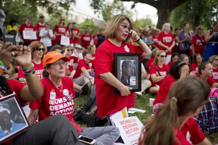 Maria Pike, center, of Chicago, holds a picture of her son Ricky Pike, who was killed by gun violence at age 24 in 2012, during a rally on the East Front lawn of the Capitol to demand that Congress take action on gun control legislation, September 10, 2015. The event, titled #Whateverittakes Day of Action, was hosted by Everytown for Gun Safety and featured speeches by political leaders and families of gun violence victims. (Photo By Tom Williams/CQ Roll Call)