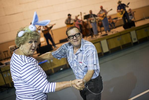 Denver McKeenley and Anna Holstein dance during a bluegrass jamboree in Belle, WV. (Tom Williams/CQ Roll Call)