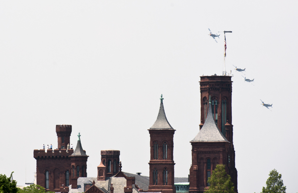 Mustang World War II era planes fly past the Smithsonian Castle. (Bill Clark/CQ Roll Call)