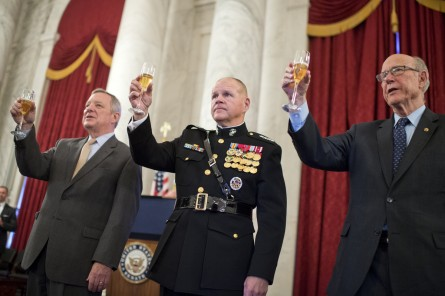 UNITED STATES - NOVEMBER 3: From left, Senate Minority Whip Richard Durbin, D-Ill., Gen. Robert B. Neller, Commandant of the Marine Corps, and Sen. Pat Roberts, R-Kan., who served in the Marine, share a toast during a 240th birthday celebration for the Marines in the Russell Building, November 3, 2015. The actual birthday is November 10th. (Photo By Tom Williams/CQ Roll Call)
