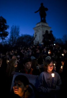 UNITED STATES - NOVEMBER 14: Participants hold candles at the base of the statue of Marquis de Lafayette in Lafayette Square across from the White House during a vigil on Saturday, Nov. 14, 2015, for the people of France in the wake of yesterday's terrorist attacks in Paris. (Photo By Bill Clark/CQ Roll Call)