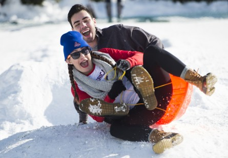 UNITED STATES - JANUARY 25: American University students Dana Foley and Bryan White sled down the hill on the West Front of the U.S. Capitol on Monday, jan. 25, 2016, after the weekend's major snowstorm dumped nearly two feet of snow in Washington over the weekend. (Photo By Bill Clark/CQ Roll Call)