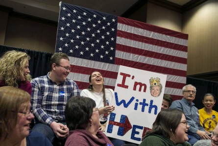 UNITED STATES - JANUARY 20 - Kayla Kaminski, from Dallas City, Ill., laughs as she waits with her homemade sign and shirt to see Democratic presidential candidate Hillary Clinton speak at an organizing event, Wednesday, Jan. 20, 2016, in Burlington, Iowa. (Photo By Al Drago/CQ Roll Call)