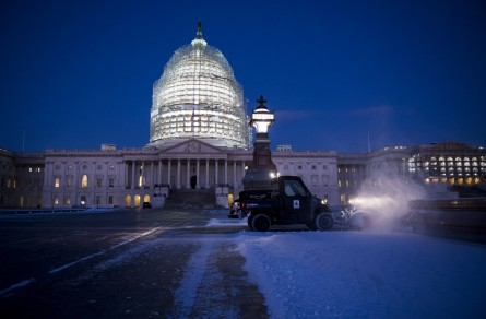 UNITED STATES - JANUARY 21: Architect of the Capitol crews clear snow from the East Plaza of the Capitol at sunrise on Thursday, Jan. 21, 2016, after a storm left about an inch of snow in the Washington area overnight. The DC area is bracing for blizzard conditions over the weekend. (Photo By Bill Clark/CQ Roll Call)