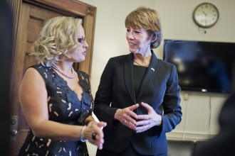 Sinema visits Rep.-elect Gwen Graham, D-Fla., during an open house in Graham's Longworth office before the 114th Congress was sworn in last month. (Tom Williams/CQ Roll Call File Photo)