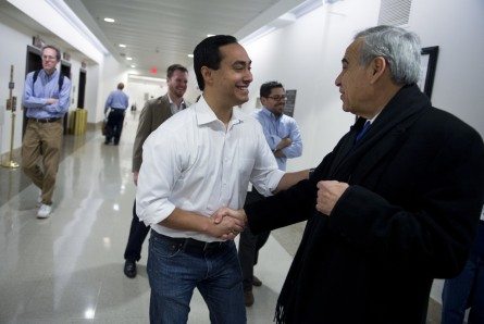 UNITED STATES - JANUARY 02:  Rep.-elect Joaquin Castro, D-Texas, left, greets outgoing member Rep. Charlie Gonzalez, D-Texas, in the basement of Longworth Building.  Castro is succeeding Gonzalez as representative for Texas's 20th District.  (Photo By Tom Williams/CQ Roll Call)