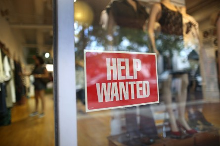 A help wanted sign is seen in the window of an Unika store on in Miami on Sept. 4. The White House contends the U.S. is in the midst of the longest period ever of private-sector job creation. (Photo by Joe Raedle/Getty Images)