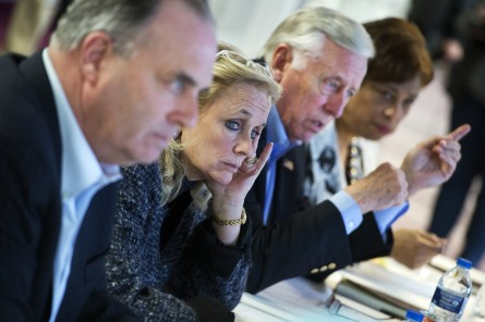 UNITED STATES - FEBRUARY 22: From left, Reps. Dan Kildee, D-Mich., Debbie Dingell, D-Mich., House Minority Whip Steny Hoyer, D-Md., and Brenda Lawrence, D-Mich., meet with officials at the Sylvester Broome Center in Flint, Mich., on the city's water crisis, February 22, 2016. The center is being used for water distribution and health care services. The water supply was not properly treated after being switched from Lake Huron to the Flint River and now contains lead and iron. (Photo By Tom Williams/CQ Roll Call)