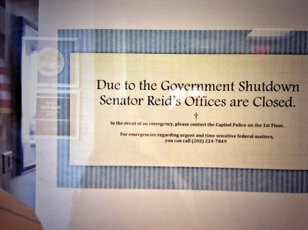 The door to Reid's fifth-floor office in the Hart Senate Office Building is one of many plastered with a sign notifying passerby that it is closed due to the government shutdown.