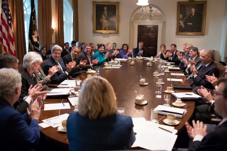 Sebelius cheered during a Cabinet meeting on Sept. 30, 2013, the day before the disastrous launch of Healthcare.gov. (Official White House Photo by Pete Souza)