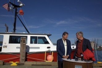 Manchin III, left, and Whitehouse hold a news conference at the Block Island ferry terminal in Point Judith, R.I. (Niels Lesniewski/CQ Roll Call).