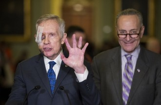 Schumer, right, says the GOP is forcing Democrats to negotiate with a gun to their heads. (Bill Clark/CQ Roll Call File Photo)