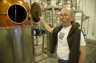 "Michael Lowe, co-owner and distiller of New Columbia Distillers, shows of the still for ""Green Hat"" distilled gin. (Chris Maddaloni/CQ Roll Call file photo.)"