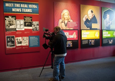 "TV crews roll tape during the media walk-through of the ""Anchorman: The Exhibit"" at the Newseum on Tuesday."