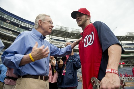 Will this be the year the Nationals deliver a championship to Washington? Senate Majority Leader Harry Reid, left, and Nats' outfield Bryce Harper want to know. (Bill Clark/CQ Roll Call File Photo.)