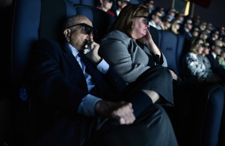 Dingell, left, himself a World War II veteran, was donned the 3-D glasses for the movie. (Tom Williams/CQ Roll Call)
