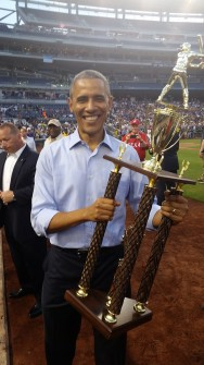 Obama, meet the Coveted Roll Call Trophy. (David Meyers/CQ Roll Call)