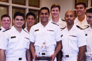 Midshipmen from the U.S. Naval Academy award winning team with their trophy for the 2015 Academy Capstone Competition. The team designed an orbital power station that would provide energy independence for forward operating bases by 2040. Boeing photo