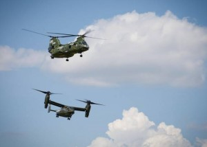 The CH-46 Sea Knight, top, conducting its final flight escorted by the MV-22 Osprey to the Smithsonian Institution National Air and Space Museum, Steven F. Udvar-Hazy Center, in Chantilly, Va., Aug. 1, 2015. (U.S. Marine Corps photo by Sgt. Tia Dufour/Released)