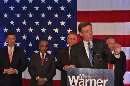 Sen. Mark Warner (front) is surrounded by fellow Virginia Democrats Rep.-elect Don Beyer (back left), Rep. Bobby Scott (back center-left), Gov. Terry McAuliffe (back center-right) and Sen. Tim Kaine (back right) while delivering the victory speech at his 2014 re-election party. (Warren Rojas/CQ Roll Call)